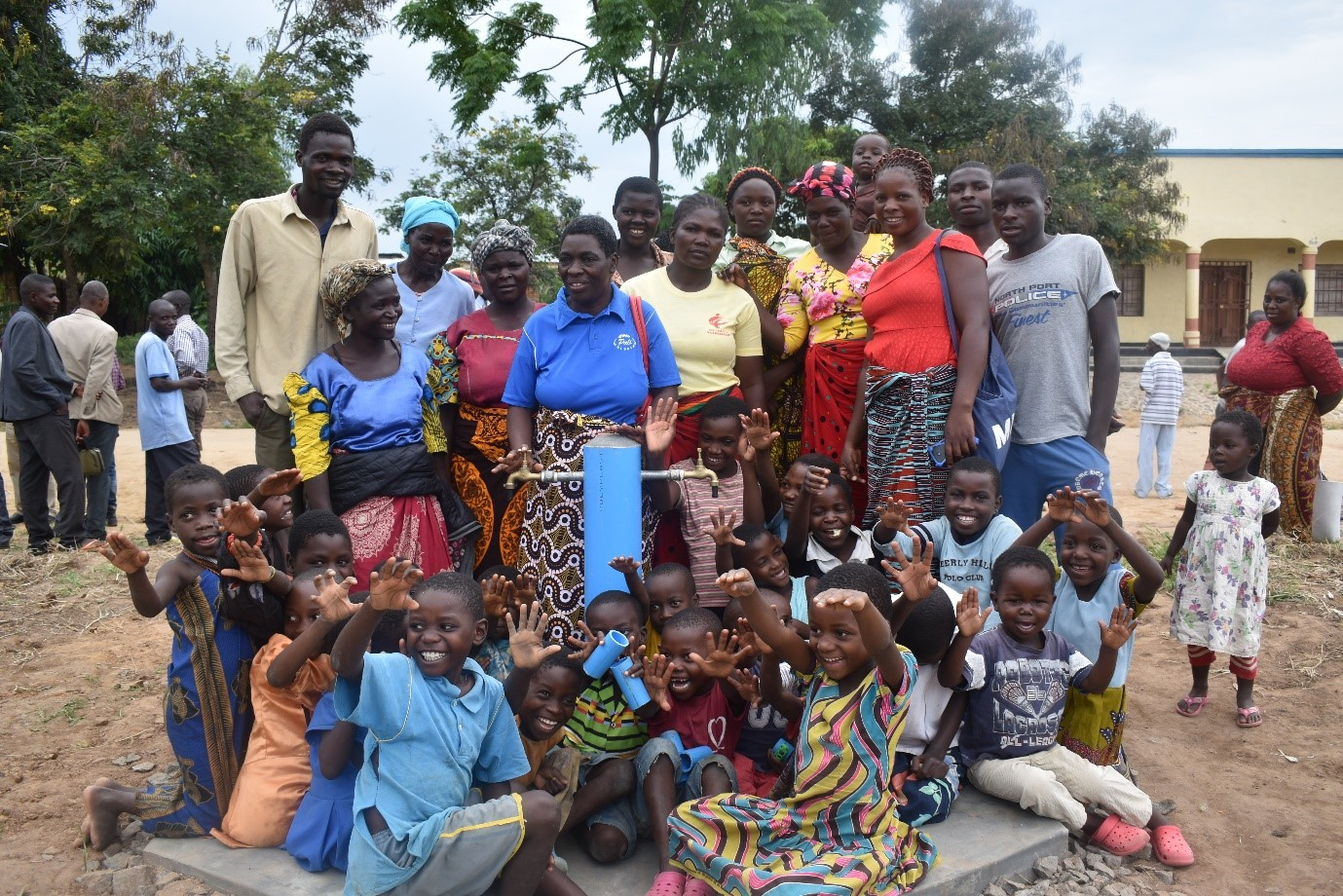 The happy Chimbiya Community embraces the new taps soon to have running water