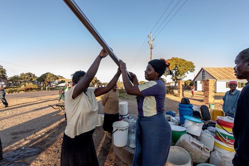 Women and other community members from Zimbabwe are struggling to access water from an ageing infrastructure which is failing to provide water to the entire community. They sometimes spend the whole day waiting for water.