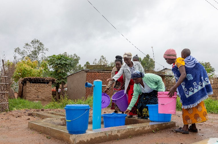Women from Chimbiya Community in Malawi are fetching water from the newly built water facility